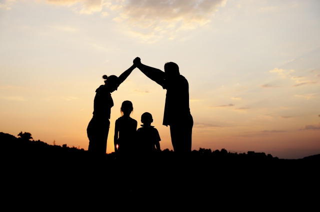 24945665 silhouette group of happy children playing on meadow su