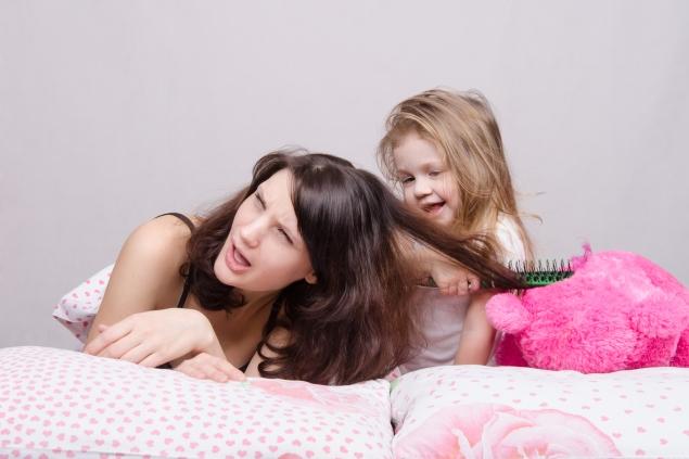 26540459 My mother is very sick Daughter combing her hair